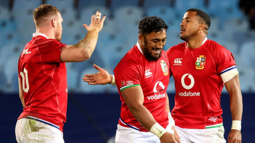 Sam Simmonds celebrates after the game with Anthony Watson and Bundee Aki