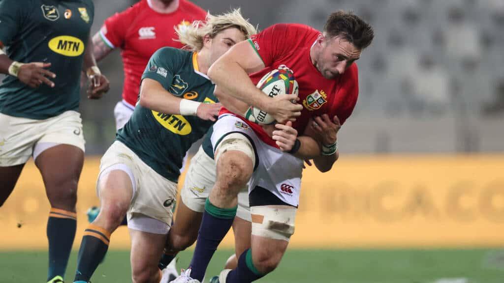 Jack Conan is tackled by Faf de Klerk
